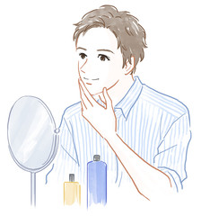 鏡をのぞく男性