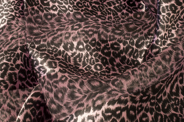 This is a photograph of a colorful animal print scarf