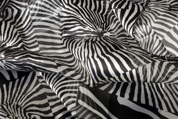 This is a photograph of a Silver and Black animal print polyester scarf