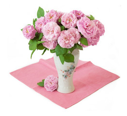 Pink roses bunch in vase on white background. Still life with pink roses bunch