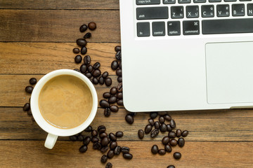 coffee bean ,coffee cup and notebook on morning work
