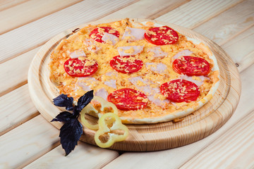 Pizza with bacon on the wooden background