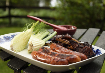 Plate with grilled sausages and ribs and fennel, picture from Sweden.