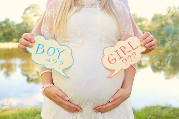 Pregnant couple choosing gender of the baby, the child's name. T