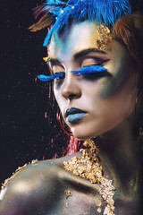 Foto auf Gartenposter Body Paint Beautiful young girl with body art in an fantasy style