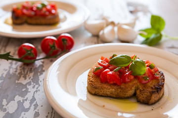 Closeup of Italian bruschetta with tomato and basil