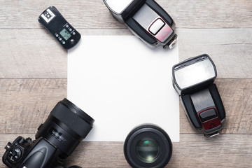 Photographer's equipment on the floor in a room with copy space.