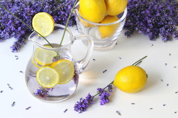 Lavender lemonade drink in a glass jar with lemon slices. Summer drink from water, lemons and lavender flowers. Photo from above. High angle view.