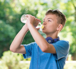Teen boy with water