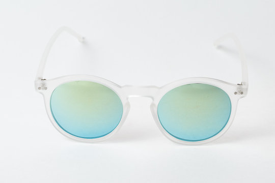 colored summer sunglasses on a white background