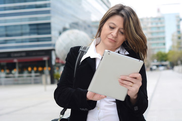 Portrait of business woman using her tablet.