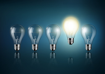 Glowing light bulb is among a lot of turned off light bulbs on dark blue background , concept idea , Transparent Vector