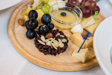 Cheese plate, grapes, nuts