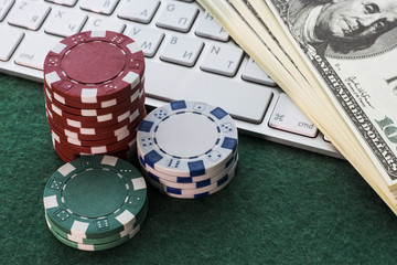 Poker game with a lot of dollars on the keyboard