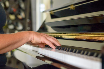 Hand of a woman playing the piano
