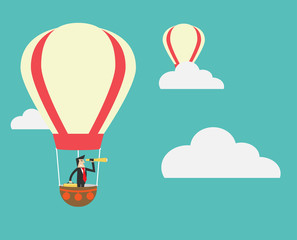 businessman look out with spyglass in hot air balloon