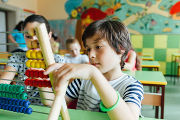 Children working with abacus