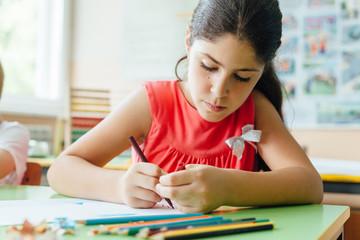 Girl drawing at school