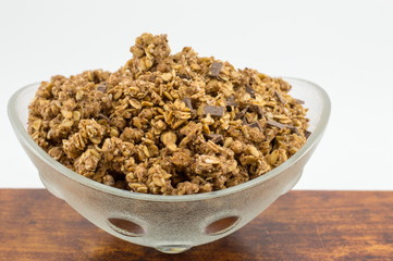 Healthy granola muesli cereals with chocolate in bowl