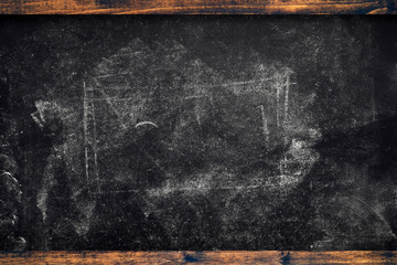 Chalk marks on dirty school blackboard with wooden frame
