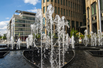 Small fountain at the park around high tech buildings