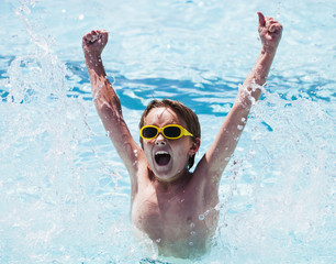 Cheerful boy in swimming pool