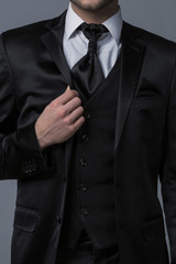 Close-up on Businessman in Black Suit on