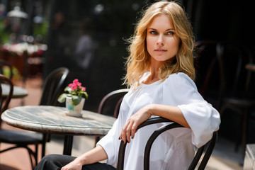 Portrait of beautiful caucasian woman in outdoor cafe