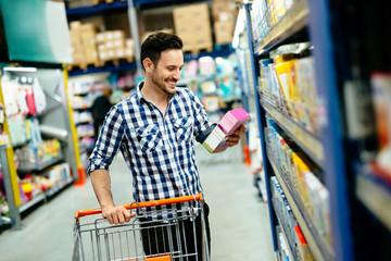 Handsome man shopping in supermarket