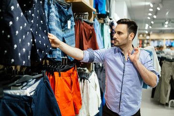 Handsome man shopping for clothes