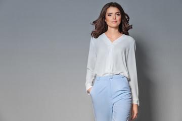 Pretty woman on grey background