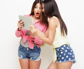 two girls friends taking selfie with digital tablet