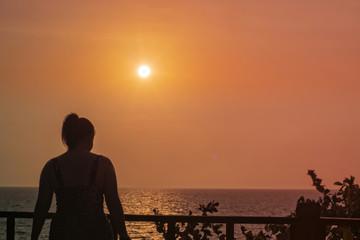 Focus blur woman walking at sunset..