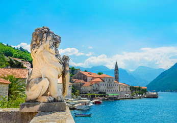 Ancient stone lion statue in Perast old town, Bay of Kotor, Montenegro, Europe