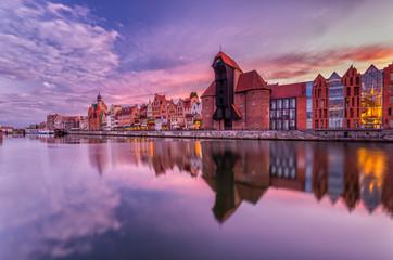 Fotobehang Stad aan het water Gdansk old town with harbor and medieval crane in the evening