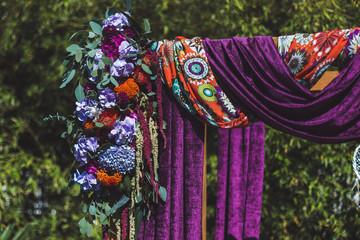 Wedding ceremony decorated in boho style