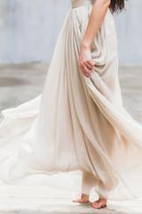 Bride dancing in a long gentle silk dress fineart style