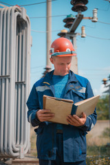Electricians on high voltage substation