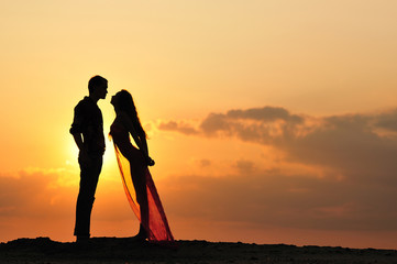silhouette of a girl and boy at sunset