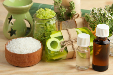 Essential oil, natural soap and aromatic salt on a wooden background. The concept of aromatherapy.