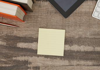Blank adhesive note on desk