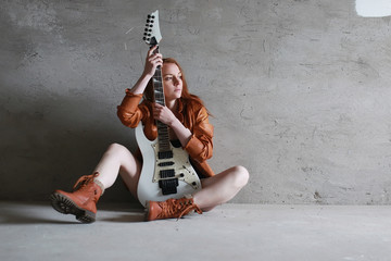 girl with electric guitar rock