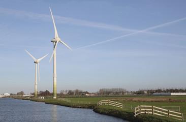 Two wind mills in a dutch landscape