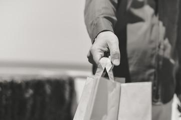 Shopping bag in hand, closeup