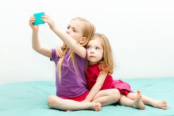 Little child taking selfie