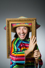Funny man with sombrero and picture frame