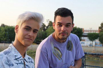PORTRAIT OF TWO GUYS LOOKING TO THE CAMERA