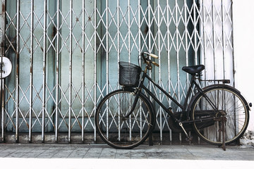 bicycle with a basket by the wall