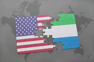 puzzle with the national flag of united states of america and sierra leone on a world map background.