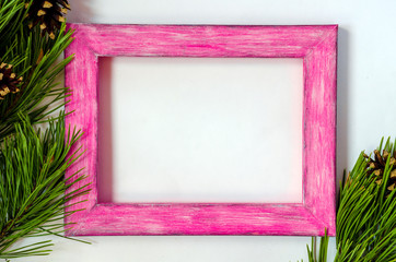 Wooden picture frame with a branch of pine-tree